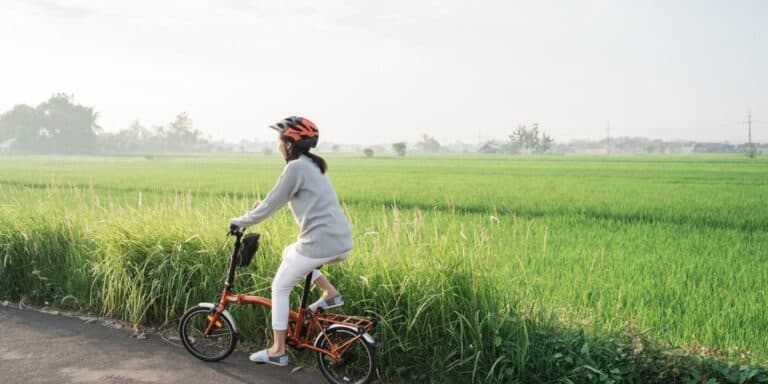 lady going for a long ride on a folding bike