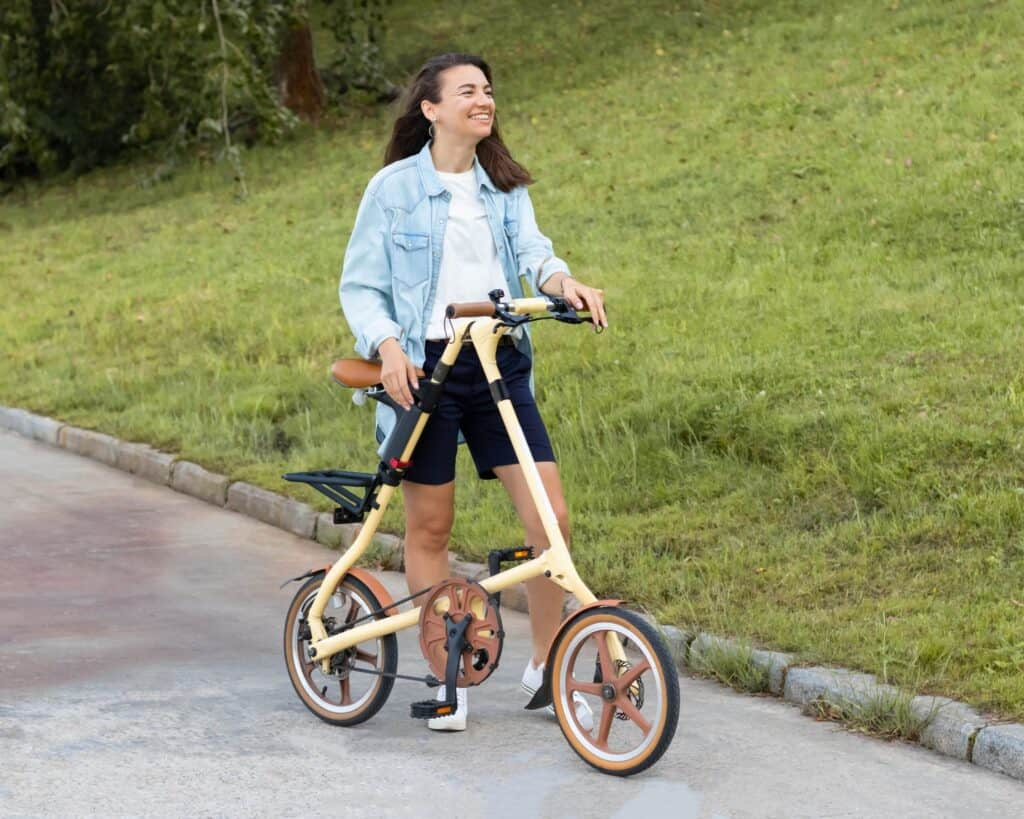 women with a silly looking folding bike