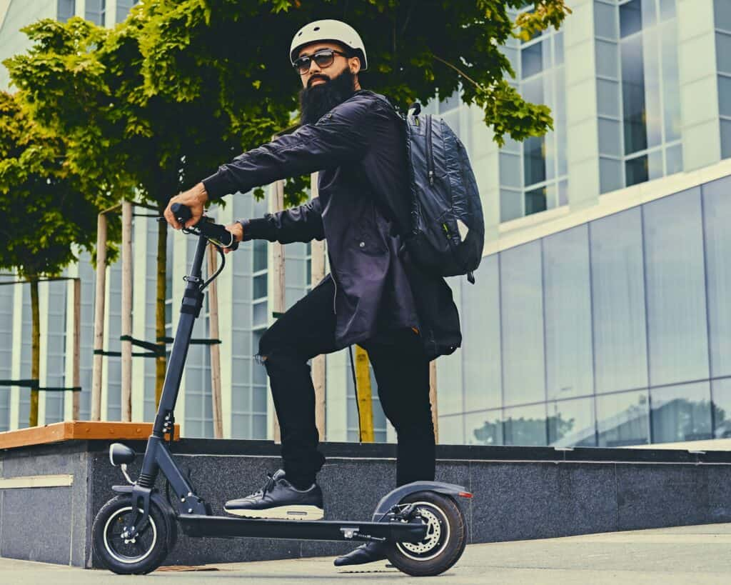 man travelling on a scooter