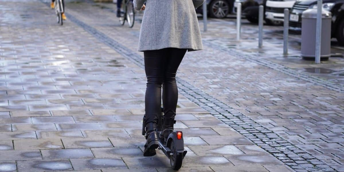 lady on an electric scooter on the road