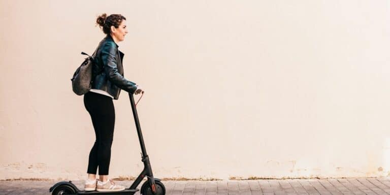 women on an electric scooter