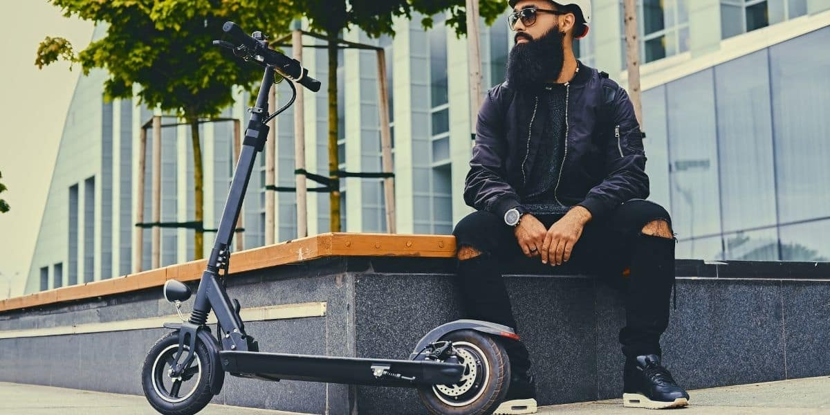 MAN WITH ELECTRIC SCOOTER